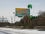 The Aloha Beach's signage. Note the Wisconsin Palm Trees.
