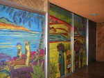 The glass doors of the Outrigger room have been painted in a Tiki mural.