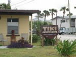 Further up the coast, we found these single story Tiki Apartments. Not very Tiki, other than a single mask we saw on the side of one building.
