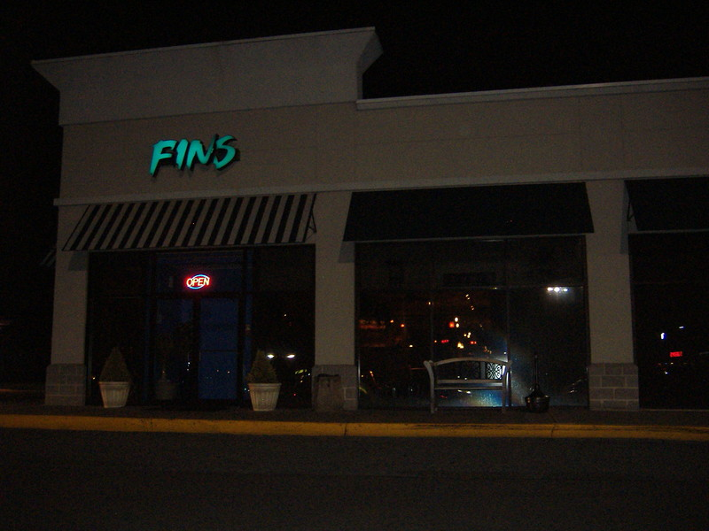 Fins, from the outside, looking like pretty much any ordinary shopping center storefront.