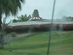A really Lousy picture taken at speed through our dirty windsheild. You can get a feel for how the earth hugs up against the side of the building and it has almost a spine at the roof peak.