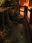 Around the base of the Tiki water garden is an intact Tiki rail.