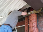 Getting in the roof, we find 2 large bolts and several thick nails holding the Tikis in place.