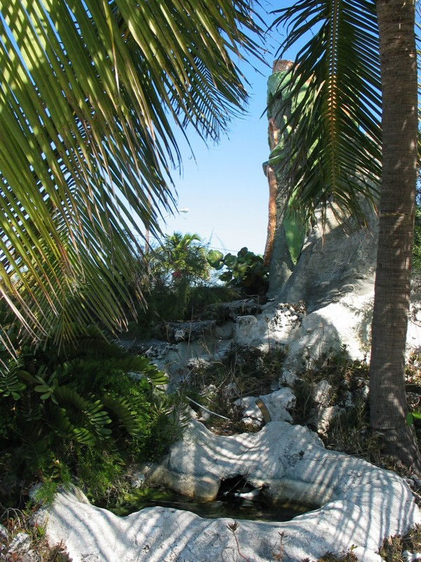 Coral 'rock' waterfall running down the side of the foliage island below the Tiki.