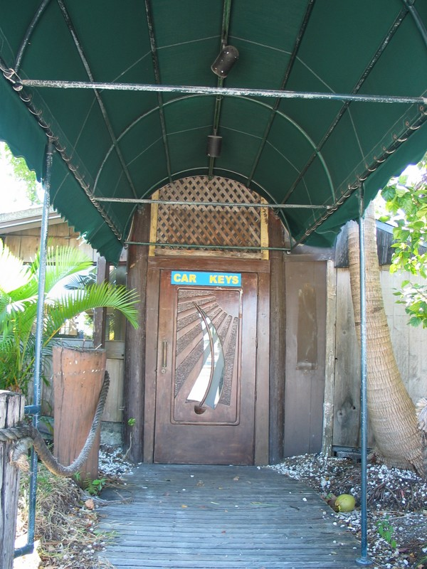 The front door, with a sailboat in the sun motif.
