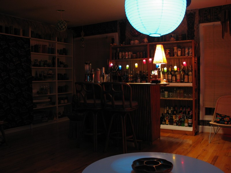 Looking across the table, towards the back left of the bar. (Ignore the cloth over the bookshelves, soon enough it'll be Tikified.)