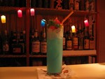 A slightly sipped Blue Hawai'i. (Normally the little Trader Vic's pic is replaced by a sword pic- we were just out that night).