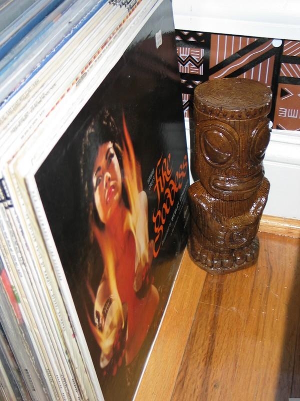Down alongside the records, a Marquesan Tiki by Seamus guards the vinyl treasures. (http://www.tikisbyseamus.com/)