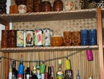 This shelf is everday mugs I serve drinks in. Up top, you can catch a glimpse of my Kahiki mugs.