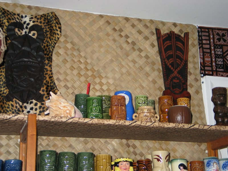 The mugs on the top shelf are either field collected, or Maryland local. At either side of the bar you can see Tiki plaques that Tiki King originally designed.