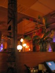 Tikis scowled down at dinners, and tropical flower arrangements added to the feel.
