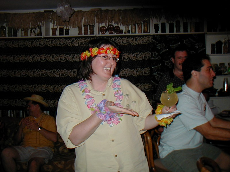"Our own Vanna White look alike displaying a ""Hula Koola"", a recipe from the Hawai'ian Room at Hotel Lexington, in NYC"
