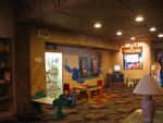 The Tahiti Trader gift shop in the main lobby. Note the matting on the walls and the 'exotic' carpet. The lobby had massive open beams with hanging plants but we have no picture.