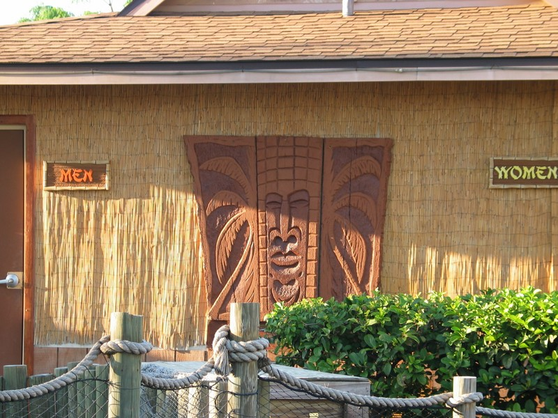a closer picture of the carving and some of the signage on the side of the hut.