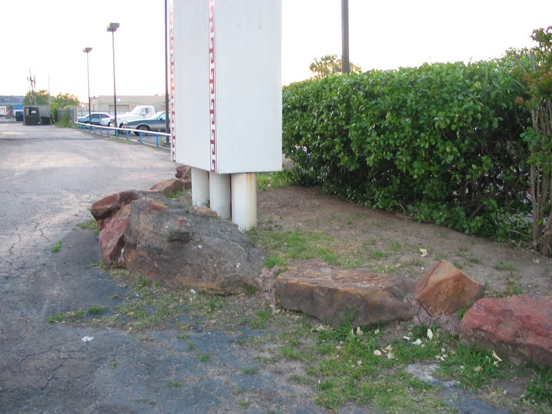 Base of the sign, interesting how the rocks may have at one time been part of more elaborate landscaping.