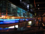 Looking along the HUGE bar with fishtanks in the center.