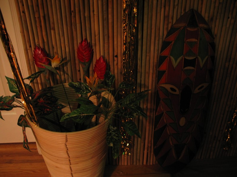 The last of the four palm tree pots, hanging out next to one of the shields.