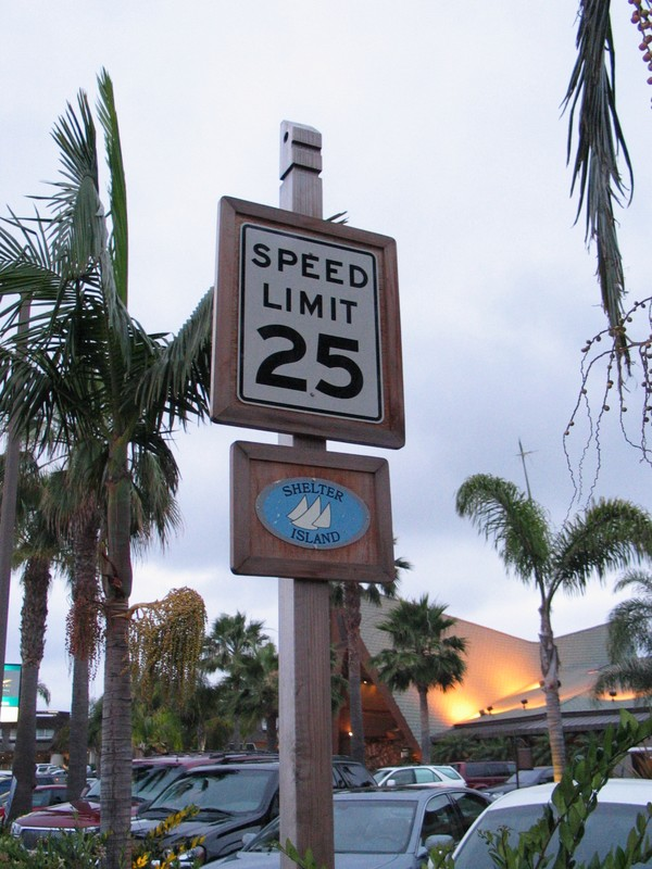 typical street signage on the island, complete with stylized Tiki head up top.