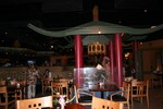 Here, I'm looking from the rear of the restaurant towards the bar area (look left) this pagoda shaped central focus has a small trickling fountain, a conch shell, some lucky bamboo, and a lamp from the Kahiki.